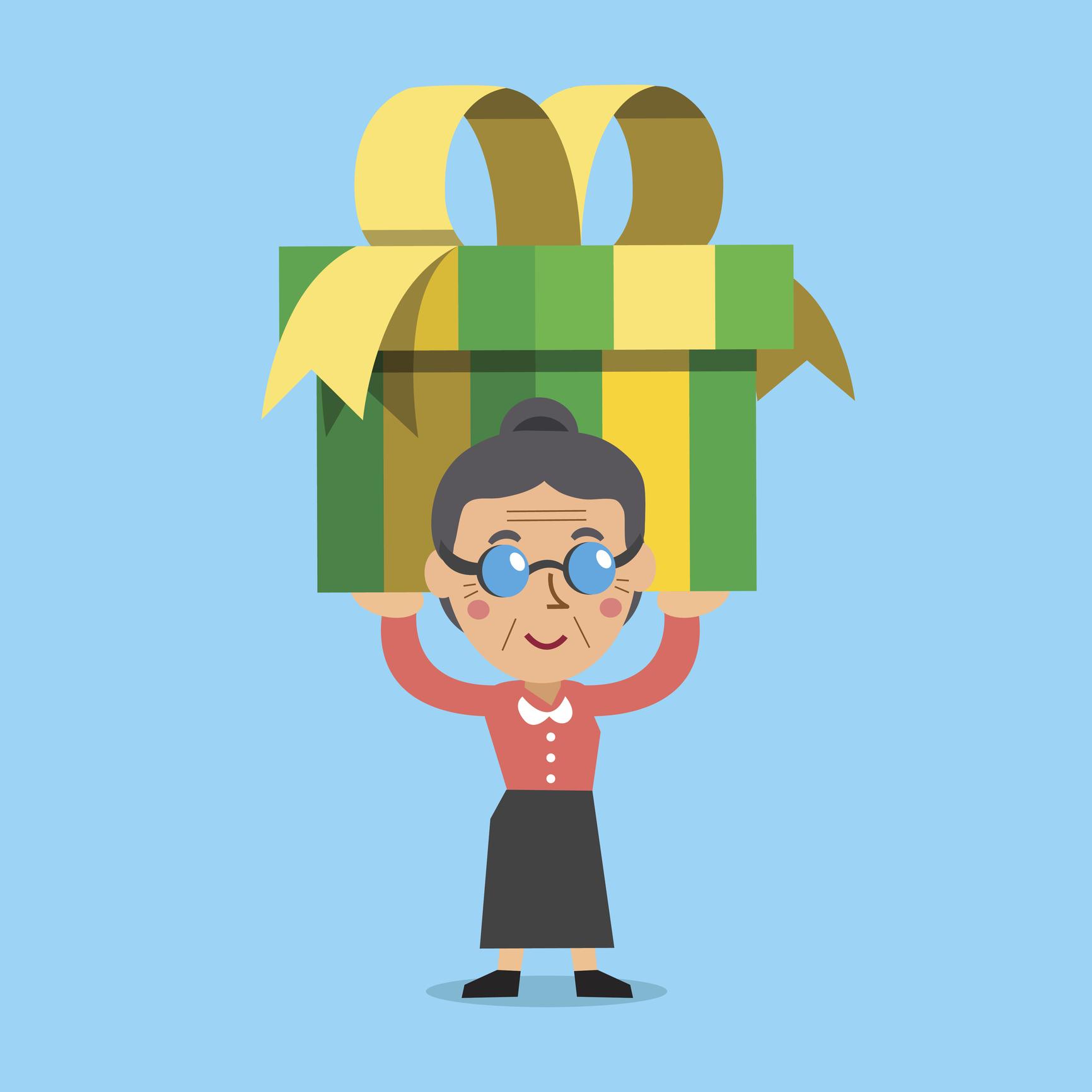 Senior woman carrying a big gift box